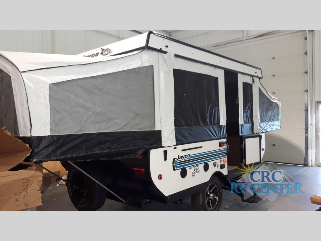 Original With Two Dinettes, It Is Easy To Seat And Accommodate More Sleeping Space In The 12UD Jay Series Sport By Jayco This Folding Popup Camper Has To The Right A Two Burner Range And Single Sink The Other Side Offers A Dinette, Storage