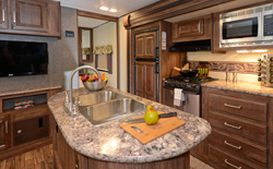shop rvs with kitchen island, picture of a kitchen island inside of a RV, rv kitchen island