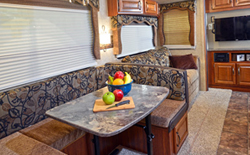 shop rvs with u shaped dinette, picture of a rv with a u shaped dinette with fruit on the table
