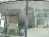 RV windshield damage before replacement.