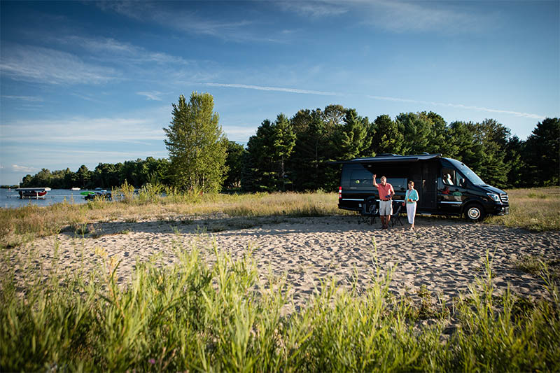 Couple with Interstate Grand Tour EXT Touring Coach