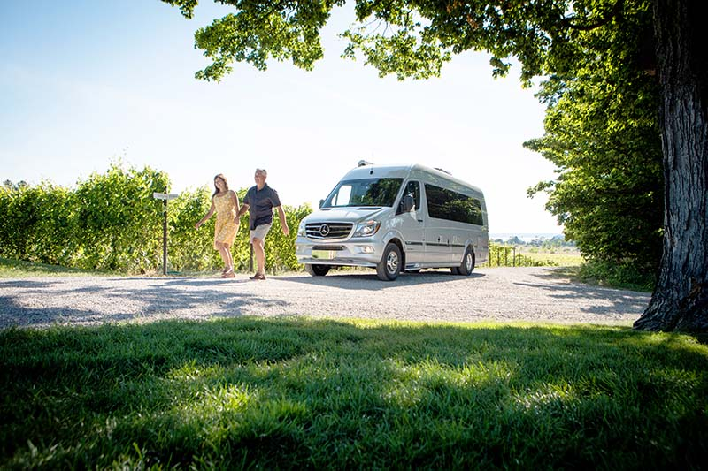 Couple with Interstate Lounge EXT Touring Coach