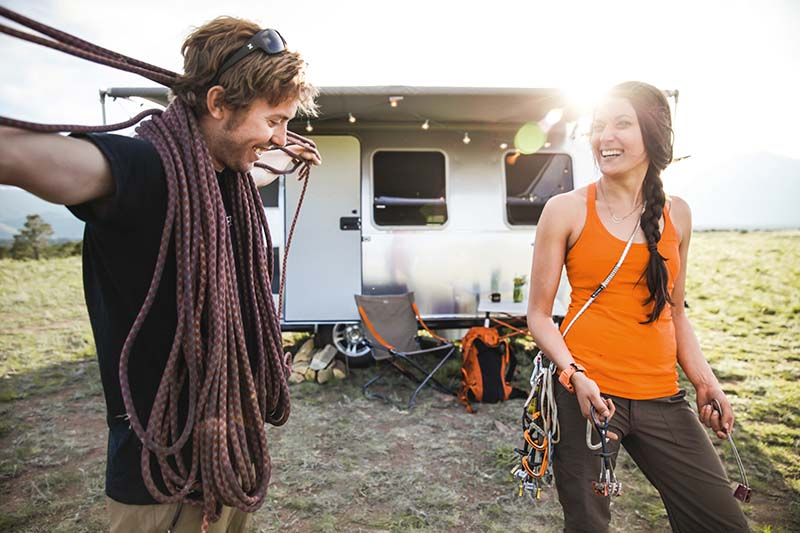 Couple camping with Airstream Sport Travel Trailer