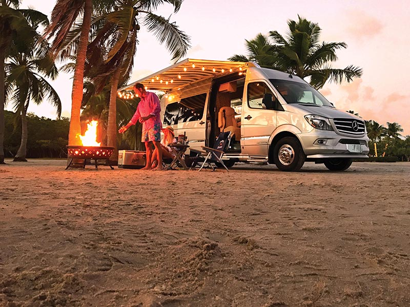 Couple Beach Camping with Tommy Bahama Interstate Touring Coach