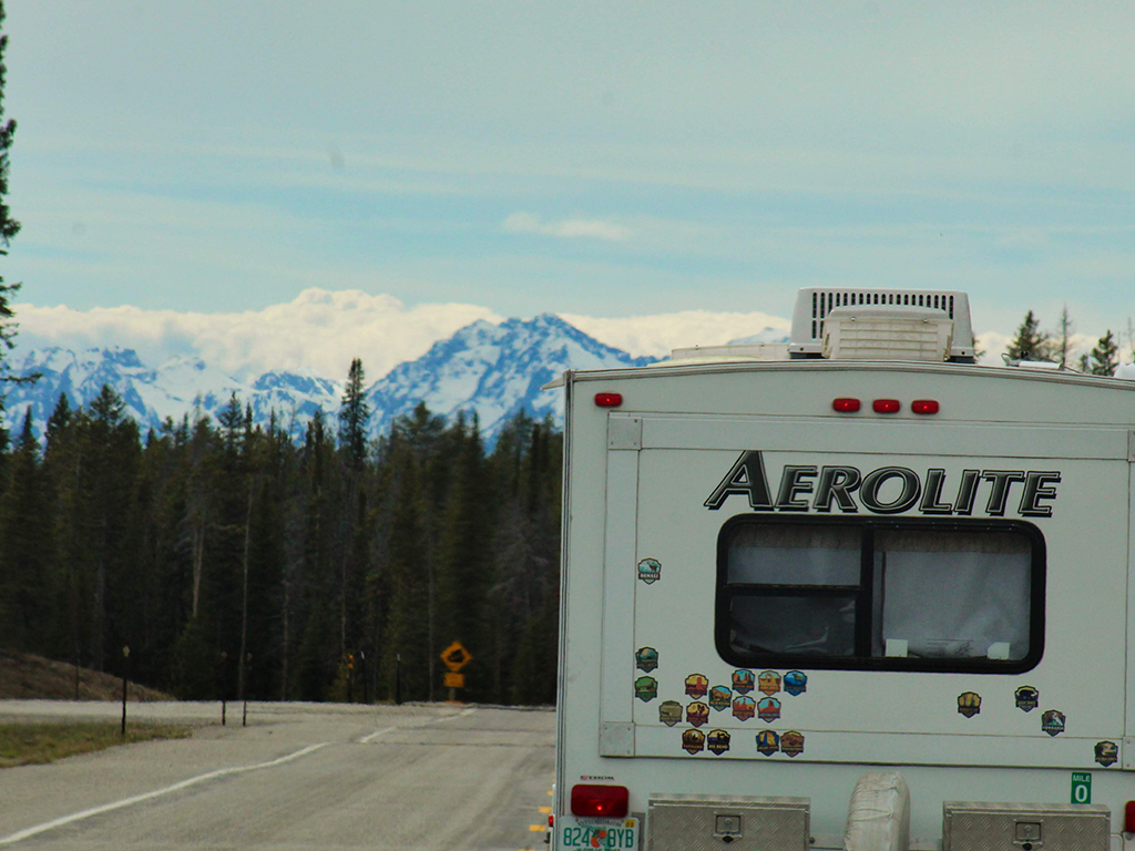 Class A Motorhome driving toward mountain