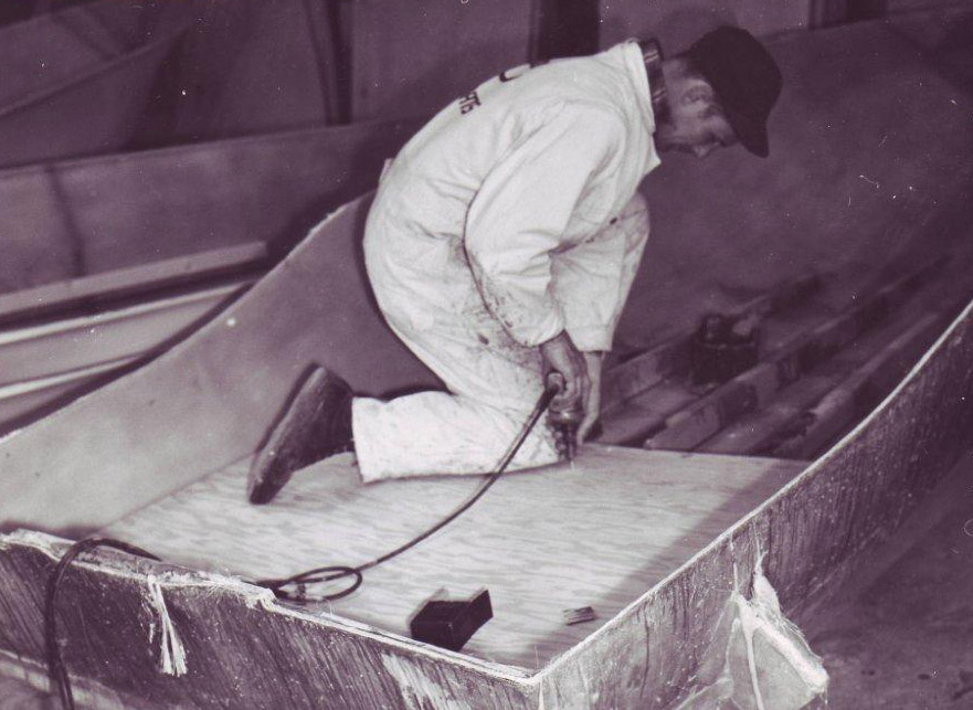 Old picture of man working on boat
