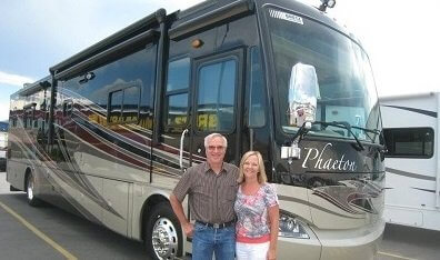 Husband and Wife in front of Motorhome