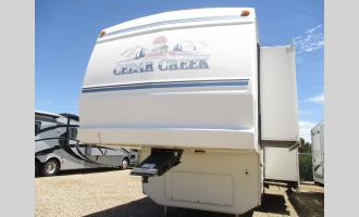 Used 2002 Forest River RV Cedar Creek 29RKB Photo
