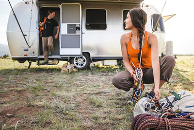 Couple outside of their Airstream RV