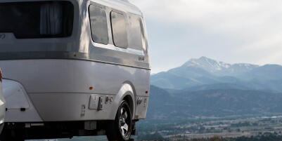 Airstream with a mountain backdrop.