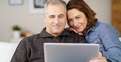Couple looking at a laptop.