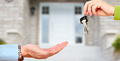 Someone handing another person some keys.