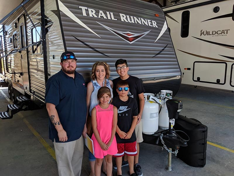Family in front of their new RV