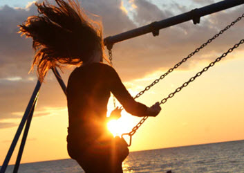 Swinging at Sunset by Noah Silliman