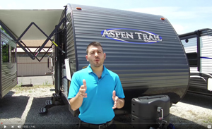 picture of chris giving a guided walk through rv tour for the aspen trail 2910bhs