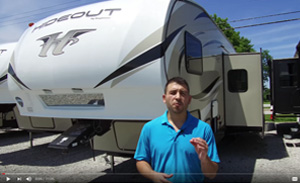 picture of a keystone hideout 308bhds with chris the rv guide standing in front of the fifth wheel