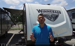 picture of chris giving a guided rv tour of the winnebago minnie 2401rg