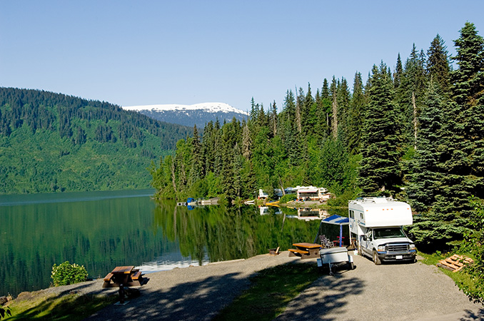 RV Camping in the wood beside a lake