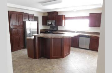 Kitchen w/high bar and stainless appliances