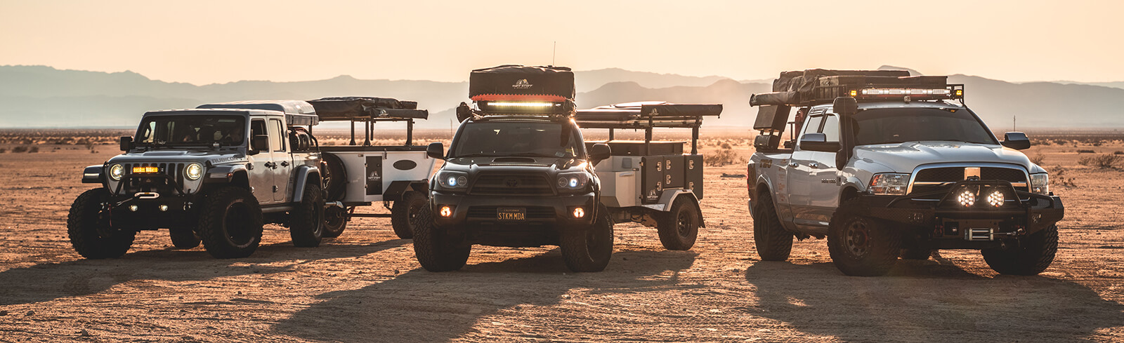 Three Tribe Overland Trailers in the desert