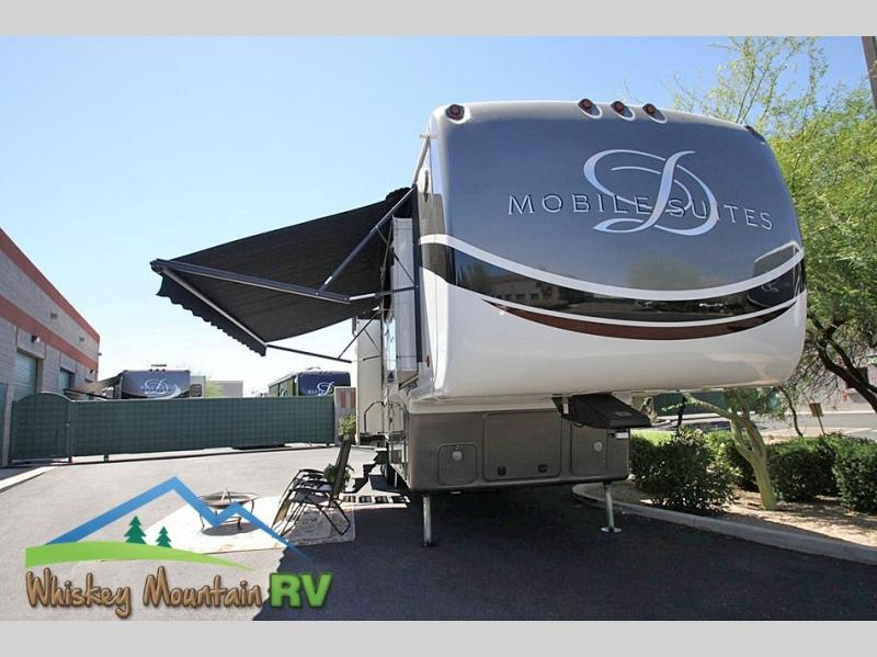 42' QUAD SLIDE LUXURY TOY HAULER WITH AN EXPANDABLE GARAGE